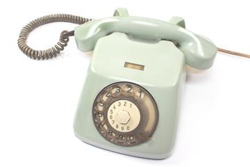Old telephone isolated on white background