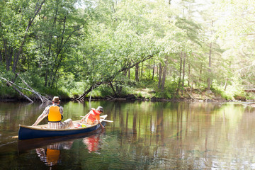 Father and son in canoe on river