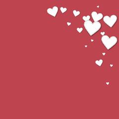 Cutout paper hearts. Top right corner on crimson background. Vector illustration.