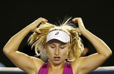 Australia's Gavrilova adjusts her hair as she sits in her chair during her fourth round match against Spain's Suarez Navarro at the Australian Open tennis tournament at Melbourne Park