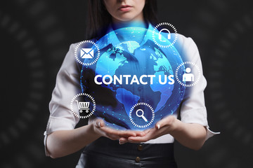 The concept of business, technology, the Internet and the network. A young entrepreneur working on a virtual screen of the future and sees the inscription: Contact us