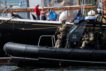 A U.S. Coast Guard Maritime Security Response Team patrols the waters around the tall ships participating in Sail Boston in Boston Harbor
