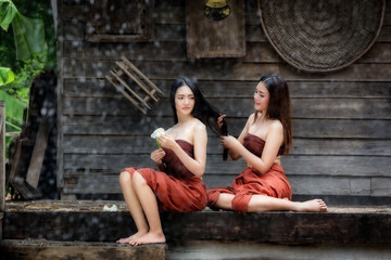 THAILAND Beautiful two women is a friend together in Thai traditional dress