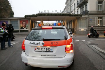 A police car of the Zurich city police drives in front the Baur au Lac hotel where Swiss police arrested FIFA officials, in Zurich