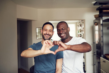 Men making heart hands gesture