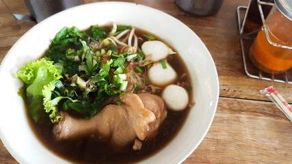 Chicken leg noodle with chicken ball in bowl