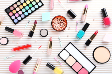 Different makeup cosmetics on paper background