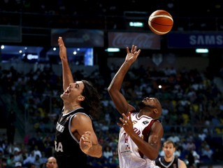 Argentina's Luis Scola jumps for the ball with Venezuela's Miguel Ruiz during their 2015 FIBA Americas Championship final basketball game.in mexico City