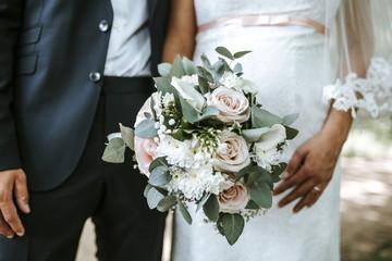 pregnant bride and bouquet