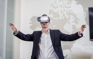 Man wearing virtual reality goggles,Businessman making gestures when wearing virtual reality goggles,virtual reality goggles concept,Smartphone using with VR headset,Future technology concept