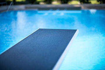 Closeup view of diving board in swimming pool
