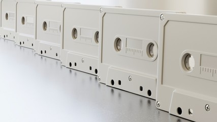 Endless line of white cassette tapes on a modern surface
