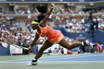Williams of the U.S. lunges for a return to Bertens of the Netherlands during their match at the U.S. Open Championships tennis tournament in New York