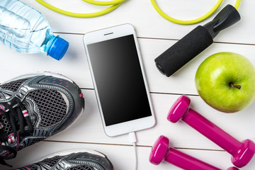 Sport or fitness accessories on white wooden background