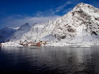 Small fishermen's village of A on Lofoten, Norway under snow-capped peaks