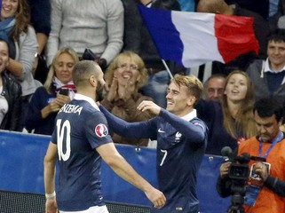 France's Antoine Griezmann celebrates with teammate Karim Benzema after scoring against Armenia during their friendly soccer match at Allianz Riviera stadium in Nice