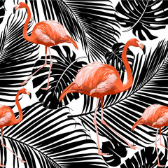 Seamless flamingo pattern with silhouettes of palm tree leaves in black on white background.