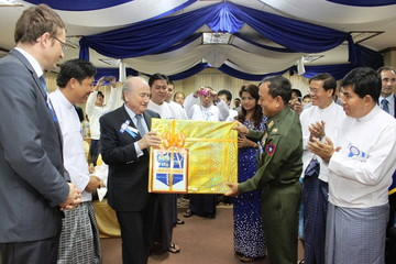 MANDALAY, March 15, 2011  Chairman of Mandalay Region Peace and Development Council, Commander of Central Command, Brigadier General Ye Aung presents a gift to International Federation of Association Football (FIFA) President Joseph S. Blatter at the opening ceremony for the Youth Football Academy in Myanmar's second largest city, Mandalay on March 15, 2011. Mr. Blatter arrived here Tuesday afternoon on a two-day-visit in Myanmar to observe the facilities constructed under the arrangement of FIFA Goal Project.  (Xinhua/Lu Zihua) (Credit Image: © Lu Zihua/Xinhua/ZUMAPRESS.com)
