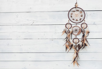 Dreamcatcher, american native amulet on wooden background. Shaman