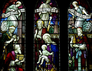 Fototapete - Three Kings visiting baby Jesus with presents in stained glass