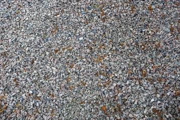 Серый фон из мелких камней строительного щебня