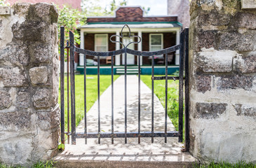 Small gate leading to entrance of house during sunny day in summer in Montreal, Quebec