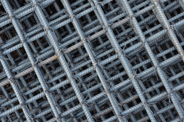 Steel wire background, Foundation rods at the construction site
