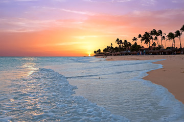 Acrylic Prints Caribbean Druif beach at sunset on Aruba island in the Caribbean sea
