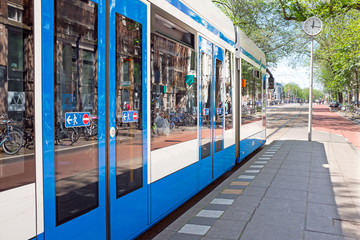 Tram departing from Weesperplein in Amsterdam Netherlands