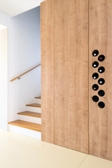 Wooden stairway with space for wine bottles in contemporary interior