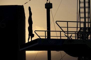 A diver competes at sunset during the Rio 2016 Olympics in Rio de Janeiro