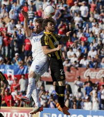 Alonso of Nacional and Nandes of Penarol compete for the ball during their soccer match for the Uruguayan tournament in Montevideo