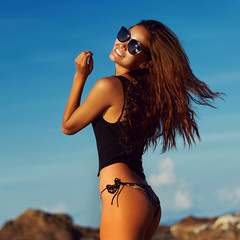 Beautiful girl in sunglasses. Summer beach portrait