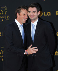 England's Graeme Swann (L) and James Anderson share a joke on the red carpet before the ICC Awards
