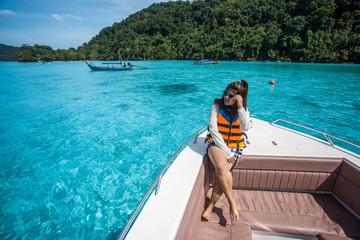 beautiful girl on the head speed boat and looking beautiful sea at Surin island