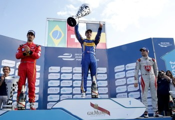 Sebastien Buemi of Renault e.Dams celebrates with the trophy with Lucas Di Grassi of ABT Schaeffler Audi Sport and Jerome D'Ambrosio of Dragon Racing  after winning the race of the E Championship in Punta del Este