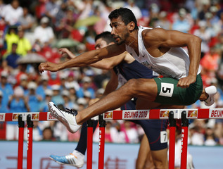Bourrada clears a hurdle on his way to winning his 110 hurdles heat in the men's decathlon at the 15th IAAF Championships in Beijing