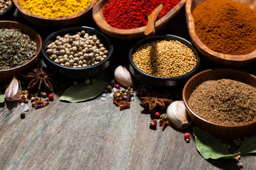 Photo sur Toile Herbe, epice assortment of various spices on a wooden table, closeup