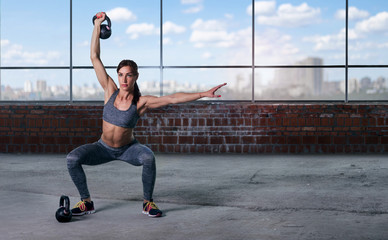 Woman athlete training with weights. Copy space