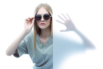 Fashion model in sunglasses, beautiful young woman.