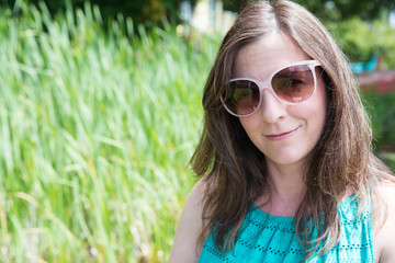Pretty woman with big sunglasses