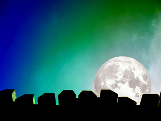 full moon silhouette of top wall and colorful sky in dust