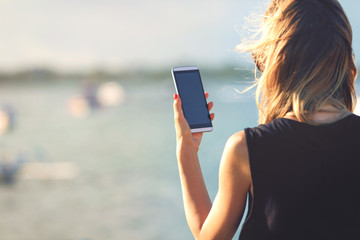 Woman using her smartphone outdoors.
