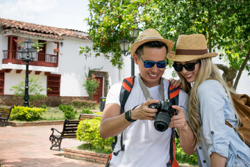 Tourists in a town taking pictures with a camera