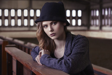 fashionable blonde girl in hat