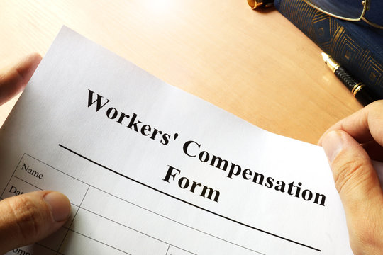 Workers compensation form on a table.