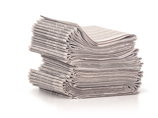 A stack of folded newspapers