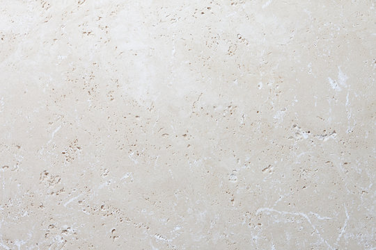 Beige stone background, natural travertine texture close up