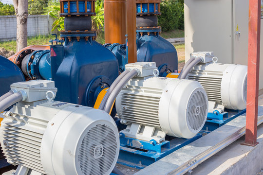 Electric motors driving water pumps of waste water treatment system.