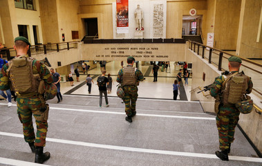 Belgian soldiers patrol inside Brussels central railway station after a suicide bomber was shot dead by troops in Brussels
